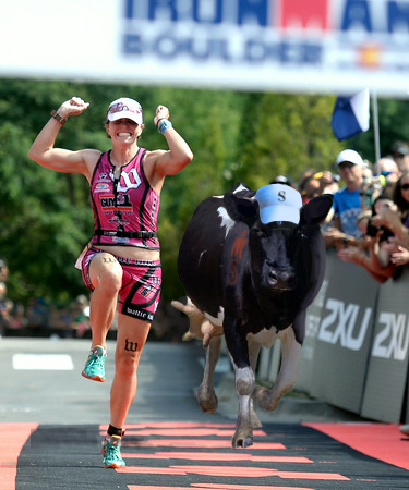 Shirley, running full tilt towards the Finish Line, nearly catches up to the Female winner at this year's Ironman Boulder Competition.
